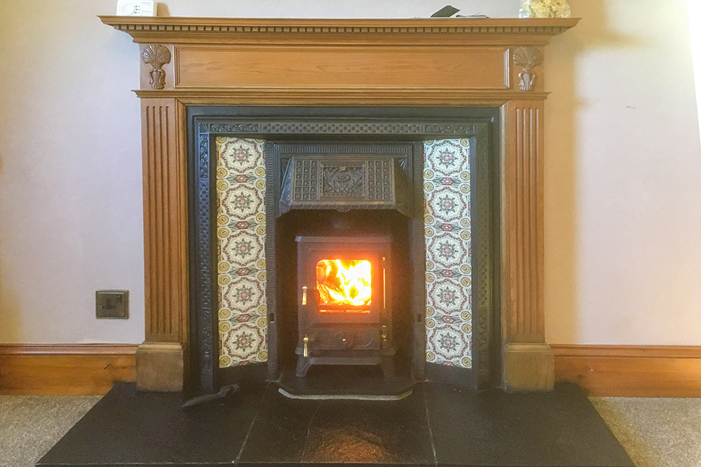 Hobbit multifuel stove fitted into an existing tiled fireplace near Buckie